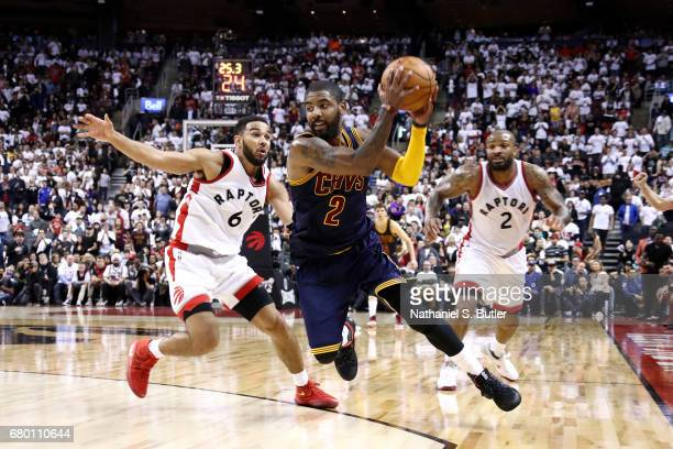 Kyrie Irving of the Cleveland Cavaliers handles the ball during the game against the Toronto Raptors in Game Four of the Eastern Conference...