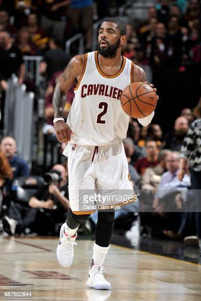 Kyrie Irving of the Cleveland Cavaliers handles the ball during the game against the Boston Celtics in Game Four of the Eastern Conference Finals of...