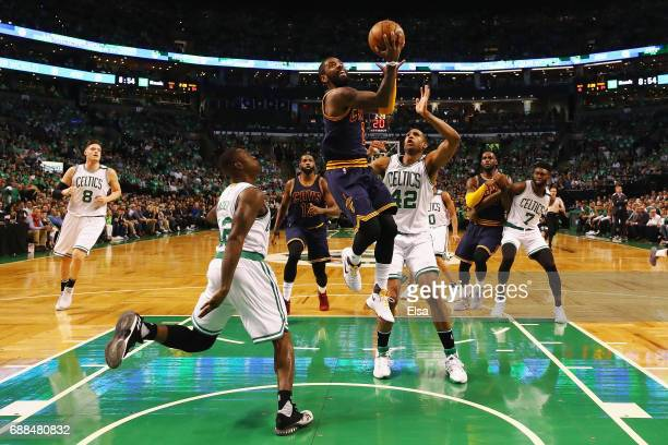 Kyrie Irving of the Cleveland Cavaliers heads for the net as Terry Rozier and Al Horford of the Boston Celtics defend in the first half during Game...