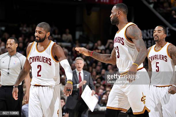 Kyrie Irving of the Cleveland Cavaliers high fives LeBron James during the game against the Philadelphia 76ers on December 20 2015 at Quicken Loans...