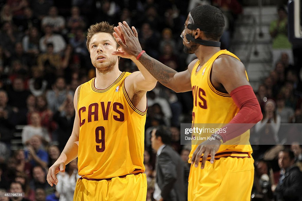 Kyrie Irving #2 of the Cleveland Cavaliers high fives teammate Matthew Dellavedova #9 during a break in the action against the Miami Heat at The Quicken Loans Arena on November 27, 2013 in Cleveland, Ohio.