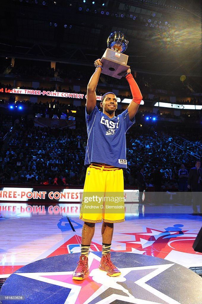 Kyrie Irving #2 of the Cleveland Cavaliers hoists his trophy for winning the 2013 Foot Locker Three-Point Contest on State Farm All-Star Saturday Night as part of 2013 NBA All-Star Weekend on February 16, 2013 at Toyota Center in Houston, Texas.