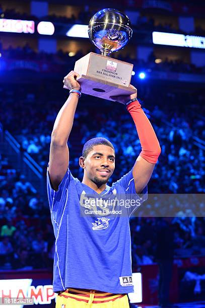 Kyrie Irving of the Cleveland Cavaliers hoists the trophy after winning the Foot Locker ThreePoint Contest on State Farm AllStar Saturday Night...