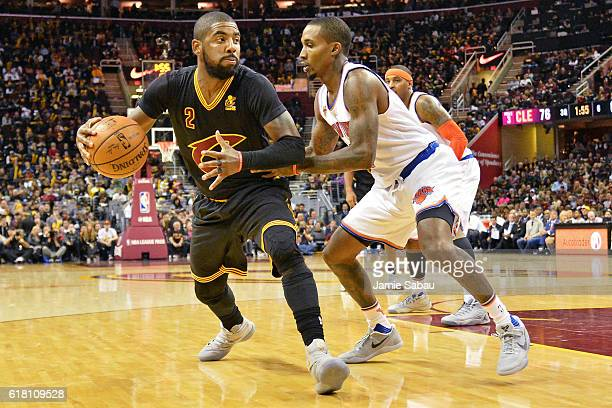 Kyrie Irving of the Cleveland Cavaliers is defended by Brandon Jennings of the New York Knicks as he looks to the basket in the third quarter on...