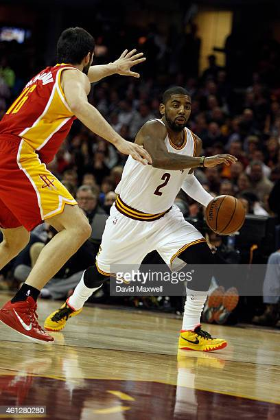 Kyrie Irving of the Cleveland Cavaliers is defended by Kostas Papanikolaou of the Houston Rockets during the first half of their game on January 7...