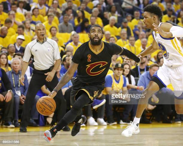 Kyrie Irving of the Cleveland Cavaliers is defended by Patrick McCaw of the Golden State Warriors during the first half in Game 5 of the 2017 NBA...