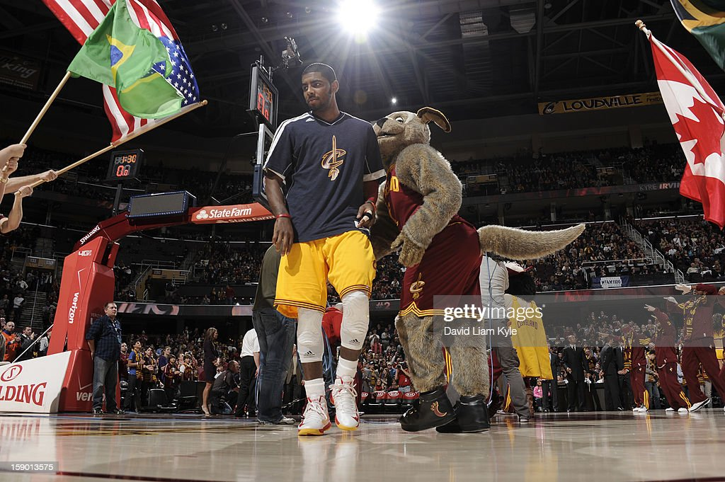 <a gi-track='captionPersonalityLinkClicked' href=/galleries/search?phrase=Kyrie+Irving&family=editorial&specificpeople=6893971 ng-click='$event.stopPropagation()'>Kyrie Irving</a> #2 of the Cleveland Cavaliers is welcomed onto the court during introductions by team mascot Moondog prior to the game against the Houston Rockets at The Quicken Loans Arena on January 5, 2013 in Cleveland, Ohio.