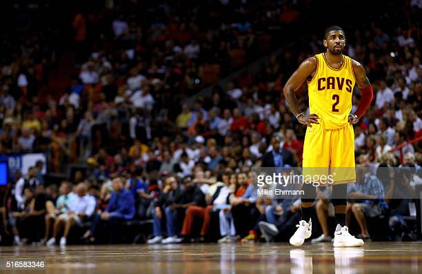Kyrie Irving of the Cleveland Cavaliers looks on during a game against the Miami Heat at American Airlines Arena on March 19 2016 in Miami Florida...