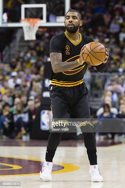 Kyrie Irving of the Cleveland Cavaliers looks to pass during the first half against the San Antonio Spurs at Quicken Loans Arena on January 21 2017...