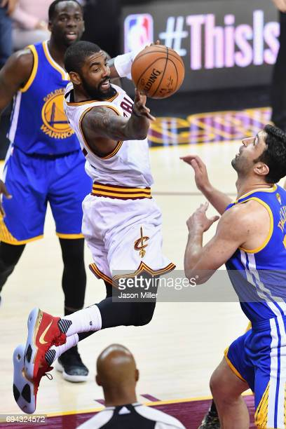 Kyrie Irving of the Cleveland Cavaliers looks to pass in the first quater against Zaza Pachulia of the Golden State Warriors in Game 4 of the 2017...