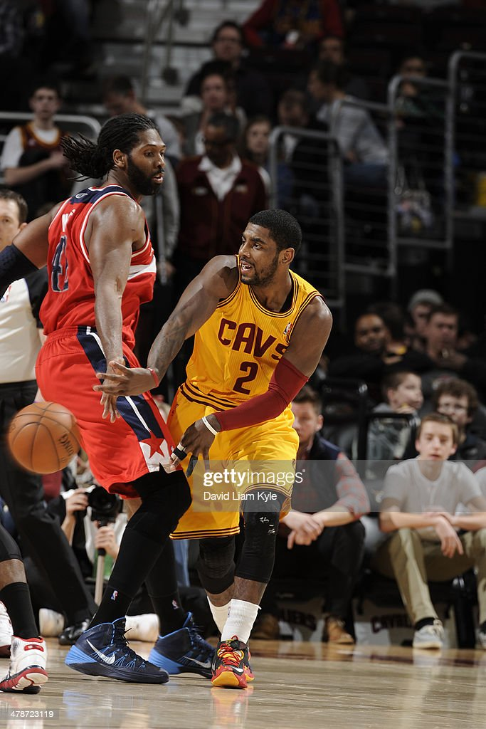 <a gi-track='captionPersonalityLinkClicked' href=/galleries/search?phrase=Kyrie+Irving&family=editorial&specificpeople=6893971 ng-click='$event.stopPropagation()'>Kyrie Irving</a> #2 of the Cleveland Cavaliers makes a pass against the Washington Wizards at The Quicken Loans Arena on February 23, 2014 in Cleveland, Ohio.
