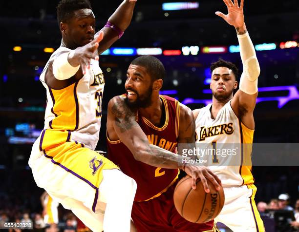 Kyrie Irving of the Cleveland Cavaliers passes out of a double team from Julius Randle and D'Angelo Russell of the Los Angeles Lakers during a 125120...