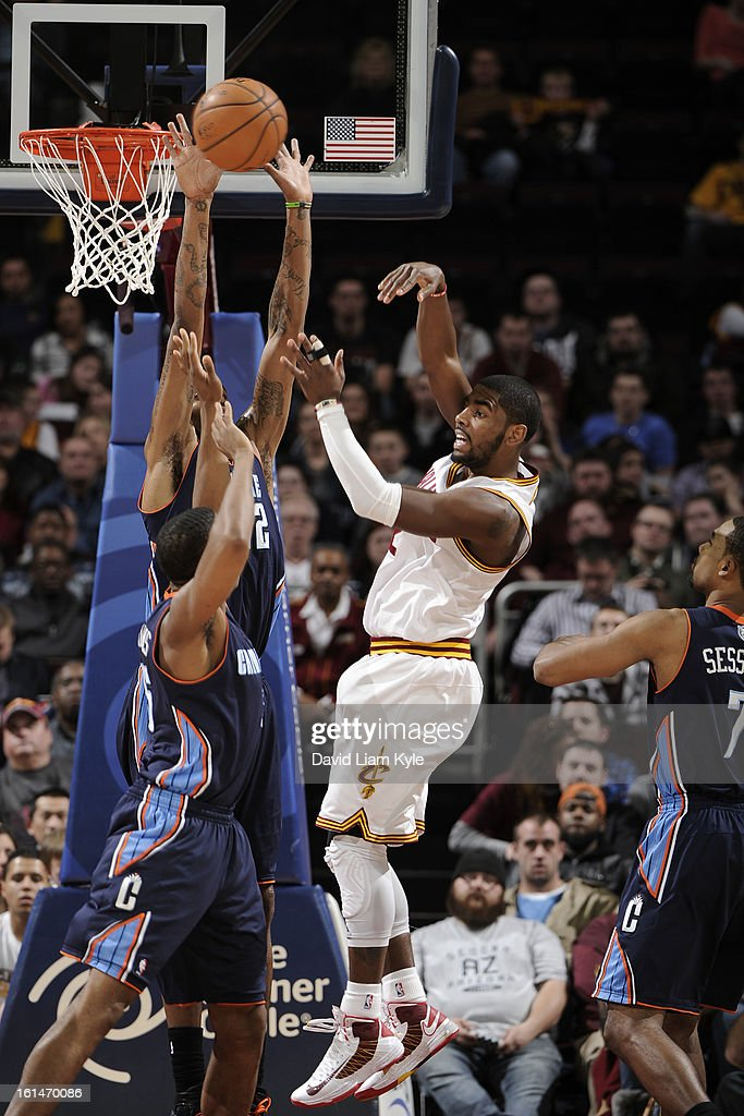 Kyrie Irving #2 of the Cleveland Cavaliers passes the ball against of the Charlotte Bobcats at The Quicken Loans Arena on February 6, 2013 in Cleveland, Ohio.
