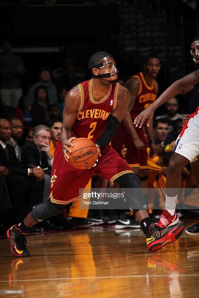 <a gi-track='captionPersonalityLinkClicked' href=/galleries/search?phrase=Kyrie+Irving&family=editorial&specificpeople=6893971 ng-click='$event.stopPropagation()'>Kyrie Irving</a> #2 of the Cleveland Cavaliers passes the ball against the Washington Wizards at the Verizon Center on December 26, 2012 in Washington, DC.