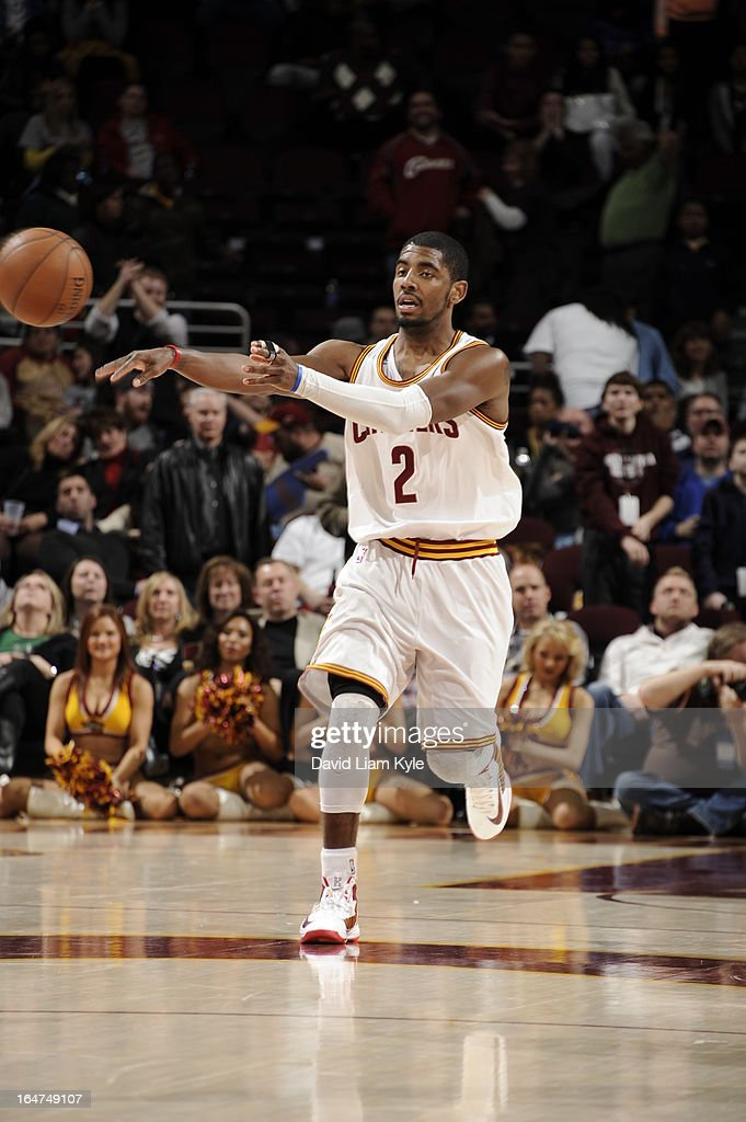 <a gi-track='captionPersonalityLinkClicked' href=/galleries/search?phrase=Kyrie+Irving&family=editorial&specificpeople=6893971 ng-click='$event.stopPropagation()'>Kyrie Irving</a> #2 of the Cleveland Cavaliers passes the ball against the Memphis Grizzlies at The Quicken Loans Arena on March 8, 2013 in Cleveland, Ohio.
