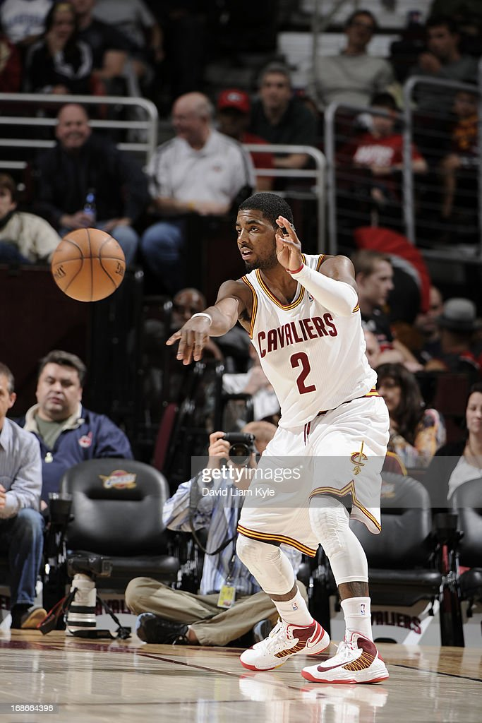 <a gi-track='captionPersonalityLinkClicked' href=/galleries/search?phrase=Kyrie+Irving&family=editorial&specificpeople=6893971 ng-click='$event.stopPropagation()'>Kyrie Irving</a> #2 of the Cleveland Cavaliers passes the ball against the Detroit Pistons at The Quicken Loans Arena on April 10, 2013 in Cleveland, Ohio.