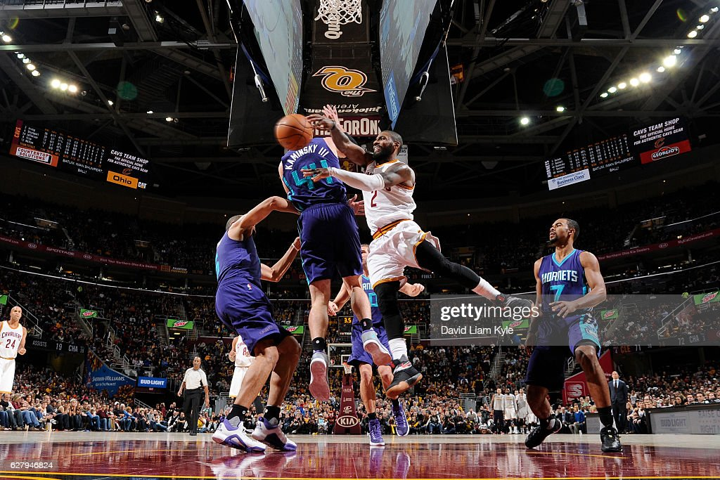 Kyrie Irving #2 of the Cleveland Cavaliers passes the ball against the Charlotte Hornets on November 13, 2016 at Quicken Loans Arena in Cleveland, Ohio.