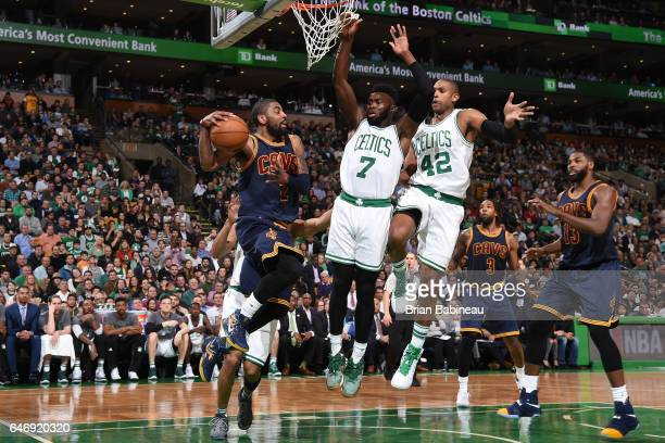 Kyrie Irving of the Cleveland Cavaliers passes the ball against the Boston Celtics on March 1 2017 at the TD Garden in Boston Massachusetts NOTE TO...