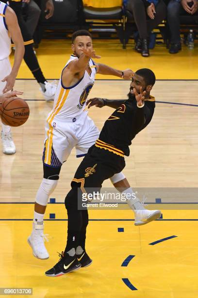 Kyrie Irving of the Cleveland Cavaliers passes the ball against the Golden State Warriors in Game Five of the 2017 NBA Finals on June 12 2017 at...