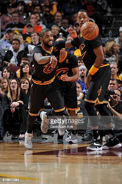 Kyrie Irving of the Cleveland Cavaliers passes the ball up court against the New York Knicks on October 25 2016 at Quicken Loans Arena in Cleveland...