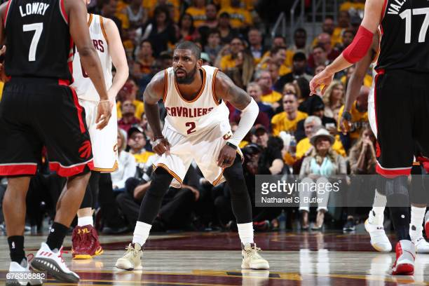 Kyrie Irving of the Cleveland Cavaliers plays defense against Kyle Lowry of the Toronto Raptors in Game One of the Eastern Conference Semifinals of...