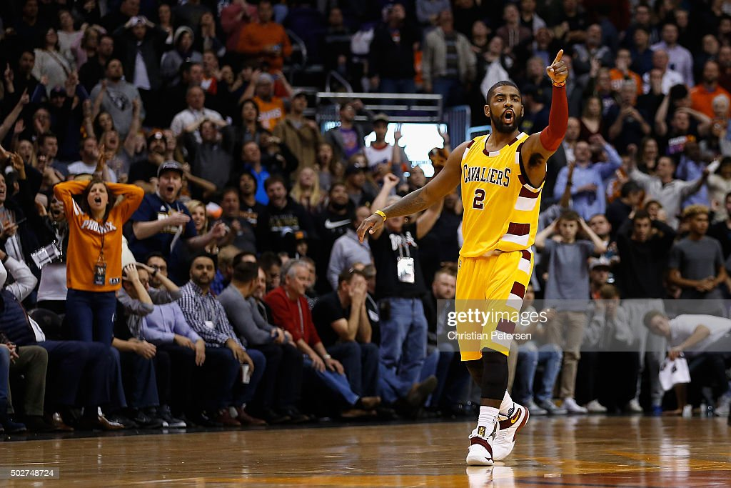 Kyrie Irving #2 of the Cleveland Cavaliers points to the bench after hitting a three point shot against the Phoenix Suns during the final moments of the NBA game at Talking Stick Resort Arena on December 28, 2015 in Phoenix, Arizona. The Cavaliers defeated the Suns 101-97.