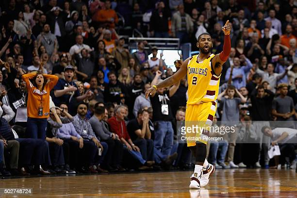 Kyrie Irving of the Cleveland Cavaliers points to the bench after hitting a three point shot against the Phoenix Suns during the final moments of the...
