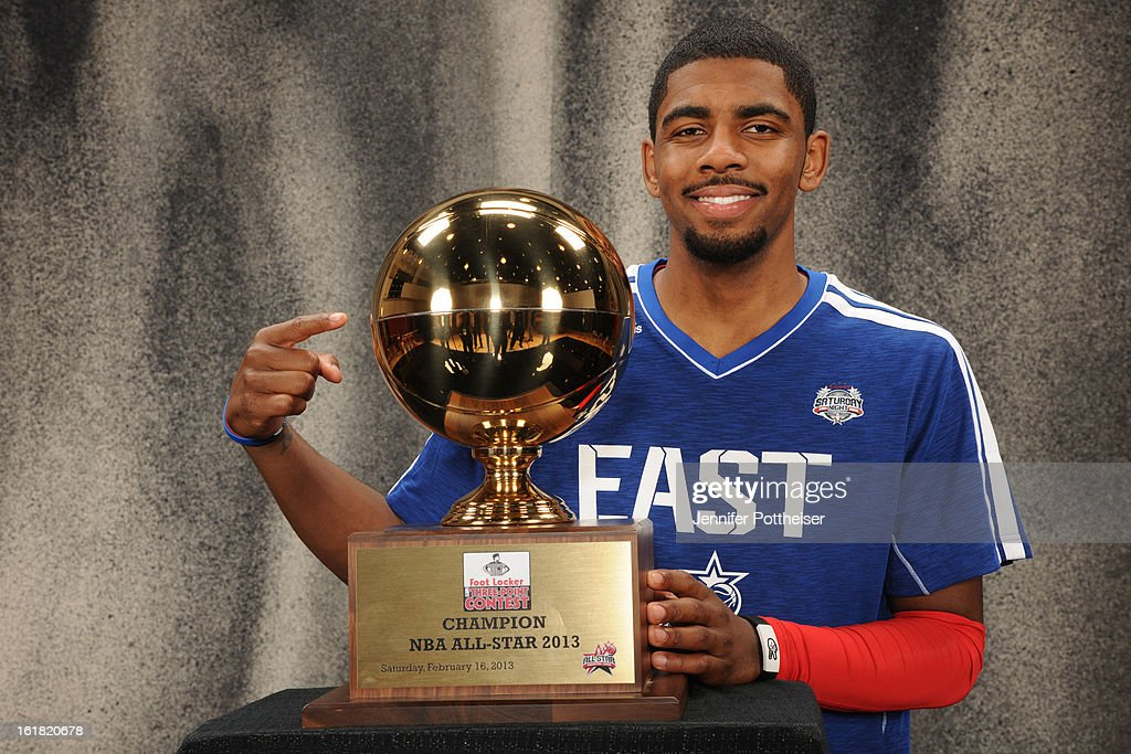 Kyrie Irving #2 of the Cleveland Cavaliers poses for portraits with the 2013 Foot Locker Three-Point Trophy during State Farm All-Star Saturday Night as part of 2013 NBA All-Star Weekends at Toyota Center on February 16, 2013 in Houston, Texas.