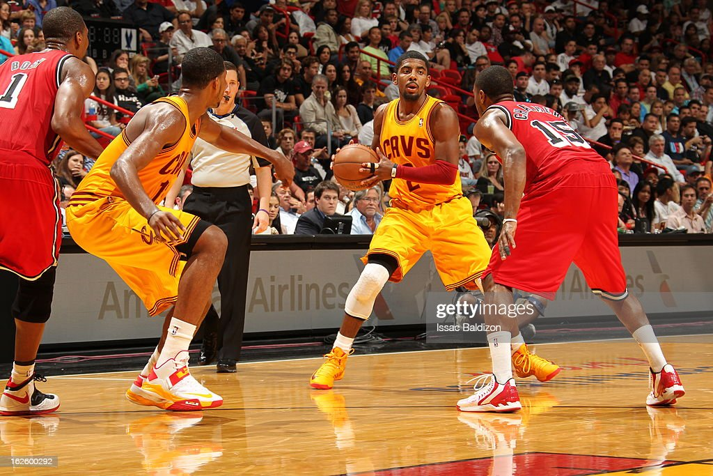 <a gi-track='captionPersonalityLinkClicked' href=/galleries/search?phrase=Kyrie+Irving&family=editorial&specificpeople=6893971 ng-click='$event.stopPropagation()'>Kyrie Irving</a> #2 of the Cleveland Cavaliers protects the ball during a game between the Cleveland Cavaliers and the Miami Heat on February 24, 2013 at American Airlines Arena in Miami, Florida.