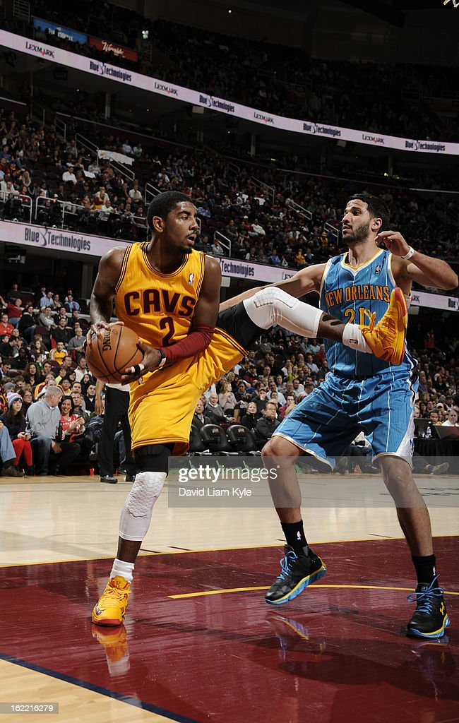 Kyrie Irving #2 of the Cleveland Cavaliers pulls down the rebound against Greivis Vasquez #21 of the New Orleans Hornets at The Quicken Loans Arena on February 20, 2013 in Cleveland, Ohio.