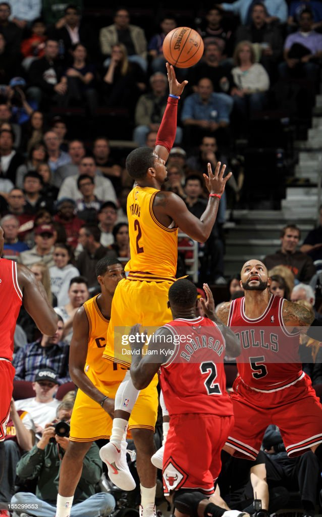 <a gi-track='captionPersonalityLinkClicked' href=/galleries/search?phrase=Kyrie+Irving&family=editorial&specificpeople=6893971 ng-click='$event.stopPropagation()'>Kyrie Irving</a> #2 of the Cleveland Cavaliers puts up the shot against <a gi-track='captionPersonalityLinkClicked' href=/galleries/search?phrase=Nate+Robinson&family=editorial&specificpeople=208906 ng-click='$event.stopPropagation()'>Nate Robinson</a> #2 and Carlos Boozer #5 of the Chicago Bulls at The Quicken Loans Arena on November 2, 2012 in Cleveland, Ohio.