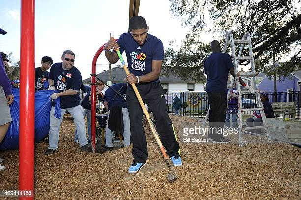 Kyrie Irving of the Cleveland Cavaliers rakes the yard during the NBA Cares AllStar Day of Service 'PLAY' with KaBOOM as part of the 2014 NBA AllStar...