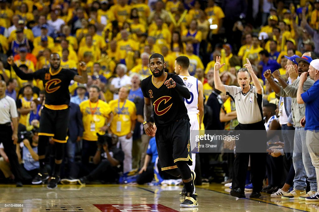 <a gi-track='captionPersonalityLinkClicked' href=/galleries/search?phrase=Kyrie+Irving&family=editorial&specificpeople=6893971 ng-click='$event.stopPropagation()'>Kyrie Irving</a> #2 of the Cleveland Cavaliers reacts after a three-point basket against the Golden State Warriors in Game 7 of the 2016 NBA Finals at ORACLE Arena on June 19, 2016 in Oakland, California.