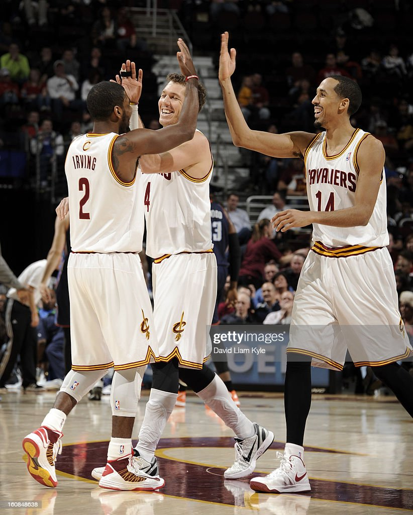 Kyrie Irving #2 of the Cleveland Cavaliers receives high fives from teammates Luke Walton #4 and Shaun Livingston #14 after he hit a three pointer against the Charlotte Bobcats at The Quicken Loans Arena on February 6, 2013 in Cleveland, Ohio.
