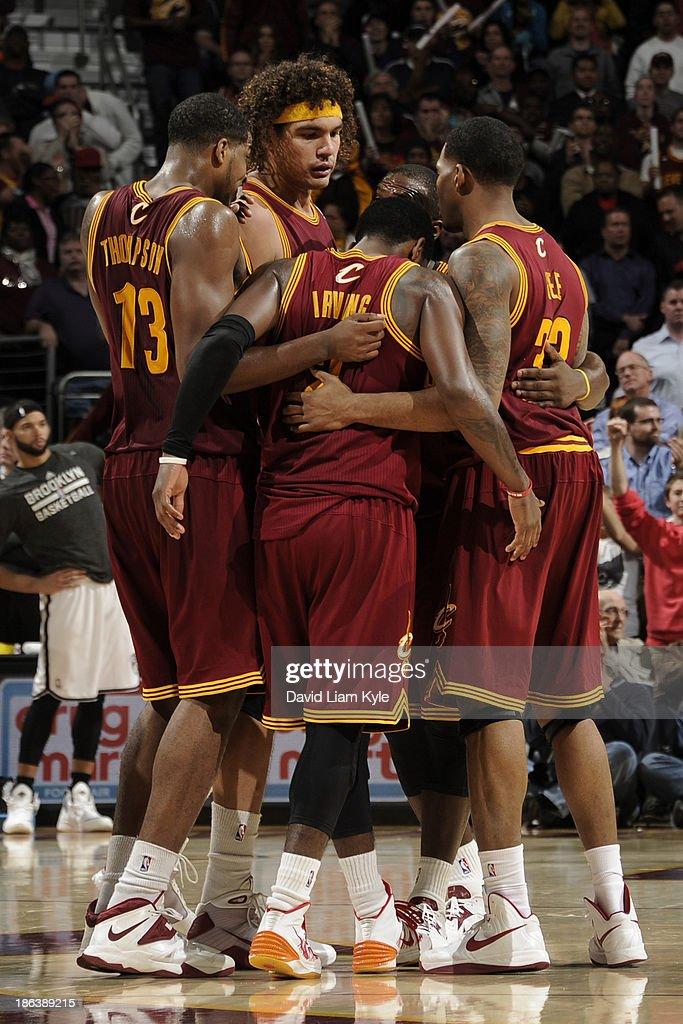 Kyrie Irving #2 of the Cleveland Cavaliers receives support from his teammates prior to sinking a couple of free throws late in their victory over the Brooklyn Nets at The Quicken Loans Arena on October 30, 2013 in Cleveland, Ohio.