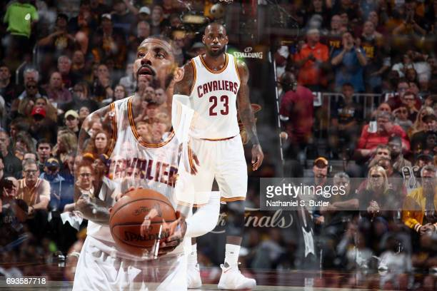 Kyrie Irving of the Cleveland Cavaliers shoots a free throw and LeBron James of the Cleveland Cavaliers looks on during the game against the Golden...