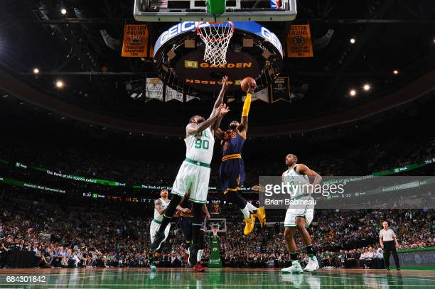 Kyrie Irving of the Cleveland Cavaliers shoots a lay up during the game against Amir Johnson of the Boston Celtics during Game One of the Eastern...