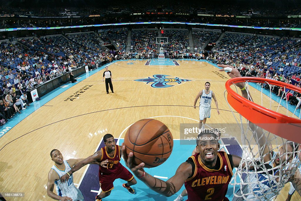<a gi-track='captionPersonalityLinkClicked' href=/galleries/search?phrase=Kyrie+Irving&family=editorial&specificpeople=6893971 ng-click='$event.stopPropagation()'>Kyrie Irving</a> #2 of the Cleveland Cavaliers shoots a layup against the New Orleans Hornets on March 31, 2013 at the New Orleans Arena in New Orleans, Louisiana.