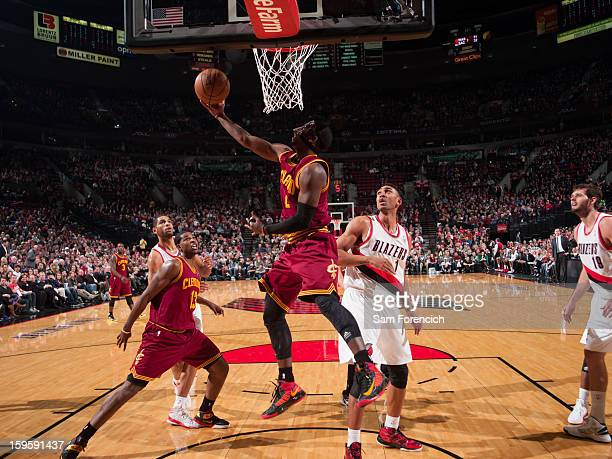 Kyrie Irving of the Cleveland Cavaliers shoots a reverse layup against Jared Jeffries of the Portland Trail Blazers on January 16 2013 at the Rose...