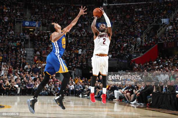 Kyrie Irving of the Cleveland Cavaliers shoots a three point basket in Game Four of the 2017 NBA Finals against the Golden State Warriors on June 9...