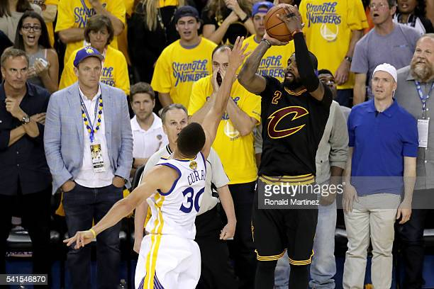 Kyrie Irving of the Cleveland Cavaliers shoots a threepoint basket against the Golden State Warriors in Game 7 of the 2016 NBA Finals at ORACLE Arena...