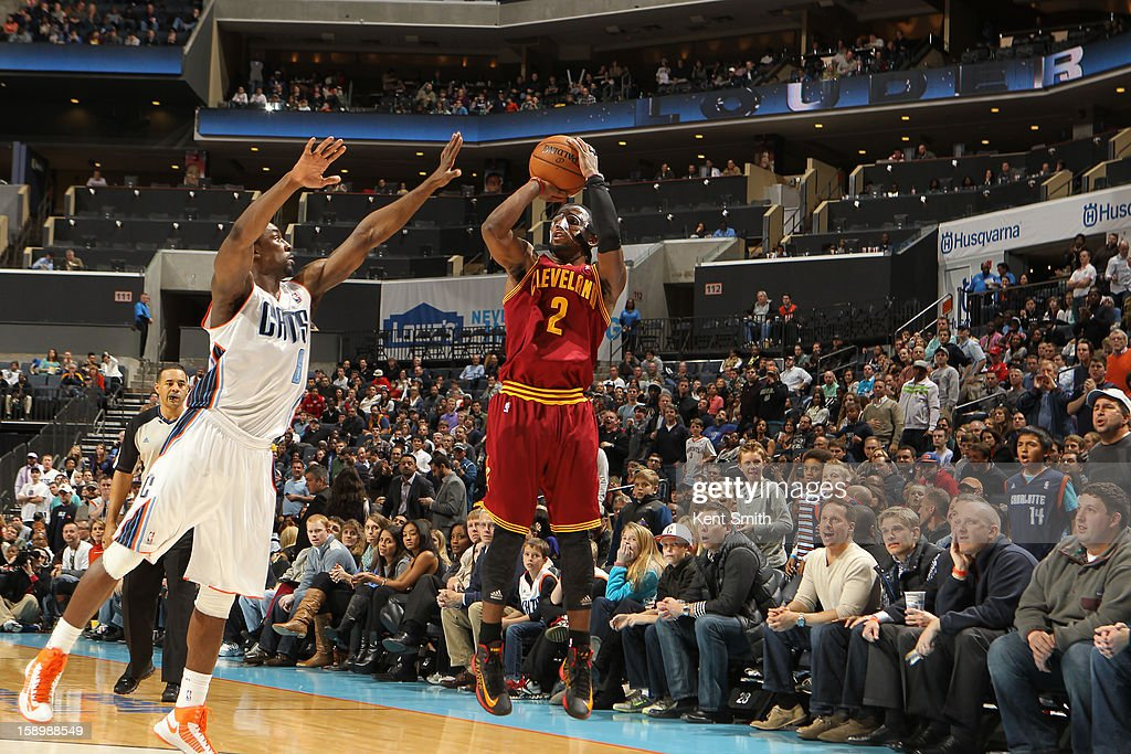 Kyrie Irving #2 of the Cleveland Cavaliers shoots against Ben Gordon #8 of the Charlotte Bobcats at the Time Warner Cable Arena on January 4, 2013 in Charlotte, North Carolina.