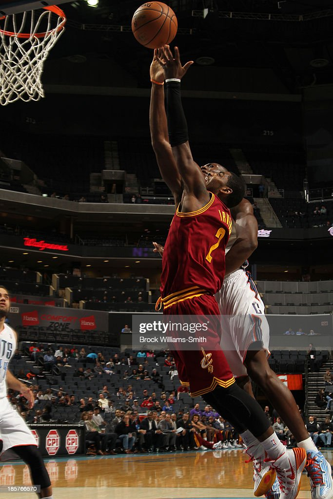 <a gi-track='captionPersonalityLinkClicked' href=/galleries/search?phrase=Kyrie+Irving&family=editorial&specificpeople=6893971 ng-click='$event.stopPropagation()'>Kyrie Irving</a> #2 of the Cleveland Cavaliers shoots against <a gi-track='captionPersonalityLinkClicked' href=/galleries/search?phrase=Bismack+Biyombo&family=editorial&specificpeople=7640443 ng-click='$event.stopPropagation()'>Bismack Biyombo</a> #0 of the Charlotte Bobcats during the game at the Time Warner Cable Arena on October 24, 2013 in Charlotte, North Carolina.