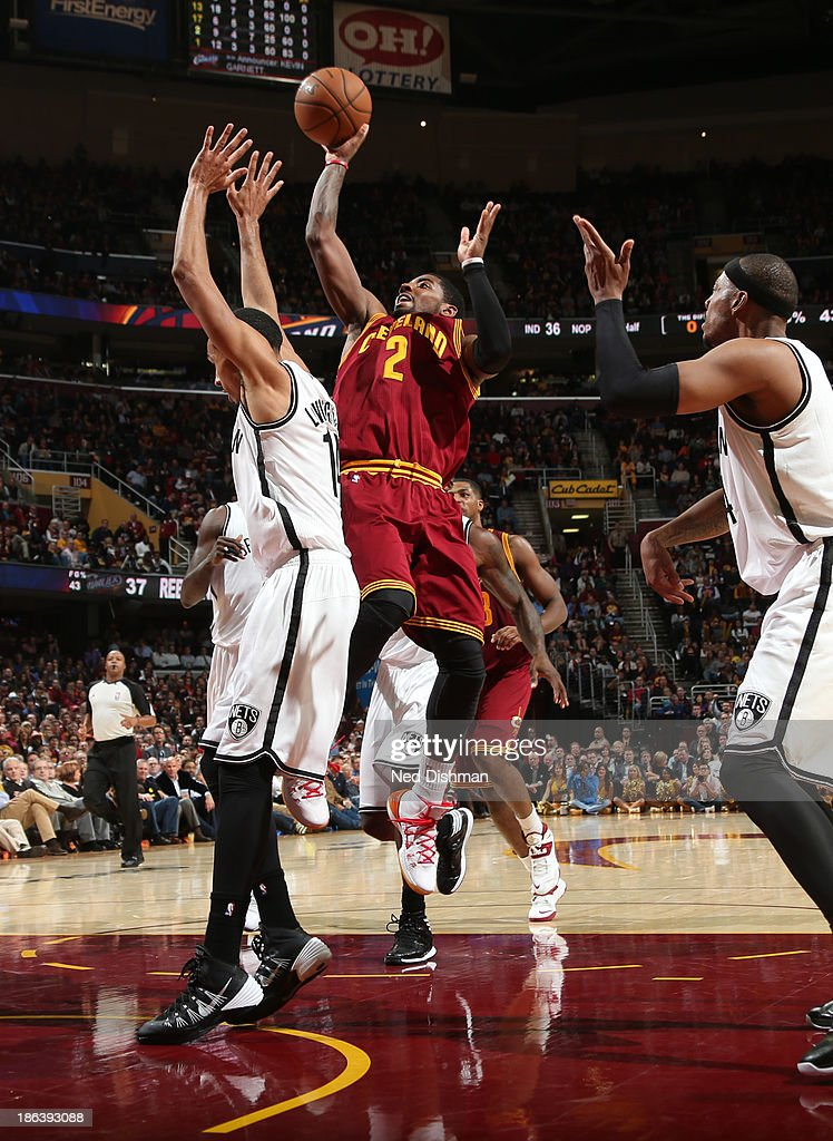 <a gi-track='captionPersonalityLinkClicked' href=/galleries/search?phrase=Kyrie+Irving&family=editorial&specificpeople=6893971 ng-click='$event.stopPropagation()'>Kyrie Irving</a> #2 of the Cleveland Cavaliers shoots against <a gi-track='captionPersonalityLinkClicked' href=/galleries/search?phrase=Brook+Lopez&family=editorial&specificpeople=3847328 ng-click='$event.stopPropagation()'>Brook Lopez</a> #11 of the Brooklyn Nets during a game at the Quicken Loans Arena on October 30, 2013 in Cleveland, Ohio.