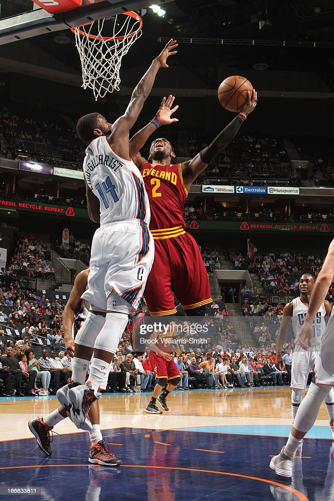 Kyrie Irving #2 of the Cleveland Cavaliers shoots against Michael Kidd-Gilchrist #14 of the Charlotte Bobcats at the Time Warner Cable Arena on April 17, 2013 in Charlotte, North Carolina.