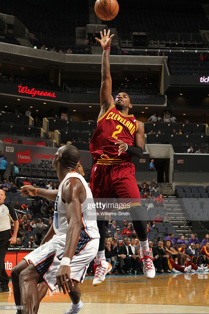<a gi-track='captionPersonalityLinkClicked' href=/galleries/search?phrase=Kyrie+Irving&family=editorial&specificpeople=6893971 ng-click='$event.stopPropagation()'>Kyrie Irving</a> #2 of the Cleveland Cavaliers shoots against the Charlotte Bobcats during the game at the Time Warner Cable Arena on October 24, 2013 in Charlotte, North Carolina.