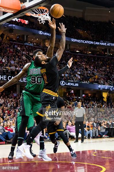 Kyrie Irving of the Cleveland Cavaliers shoots over Amir Johnson of the Boston Celtics during the first half at Quicken Loans Arena on December 29...