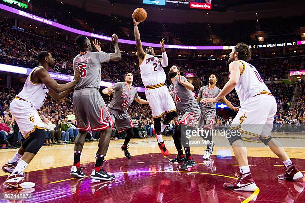 Kyrie Irving of the Cleveland Cavaliers shoots over Bobby Portis Doug McDermott Nikola Mirotic and Derrick Rose of the Chicago Bulls while Tristan...