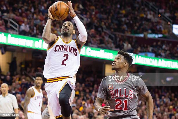 Kyrie Irving of the Cleveland Cavaliers shoots over Jimmy Butler of the Chicago Bulls during the first half at Quicken Loans Arena on January 23 2016...