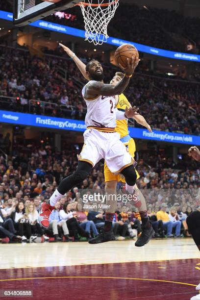 Kyrie Irving of the Cleveland Cavaliers shoots over Juancho Hernangomez of the Denver Nuggets during the second half at Quicken Loans Arena on...